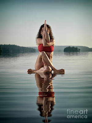 Woman Doing Sitting Variation Of Yoga Eagle Pose On The Water Poster