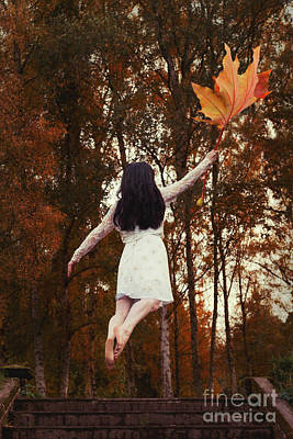 Woman Floating Away With Autumn Leaf Poster