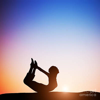Woman In Bow Yoga Pose Meditating At Sunset Poster by Michal Bednarek