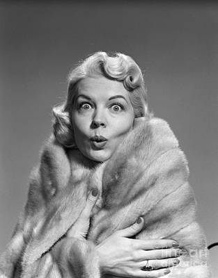 Woman In Fur With Surprised Look Poster by Debrocke/ClassicStock