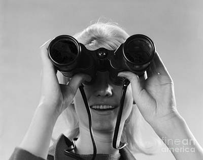 Woman Looking Through Binoculars Poster by H. Armstrong Roberts/ClassicStock