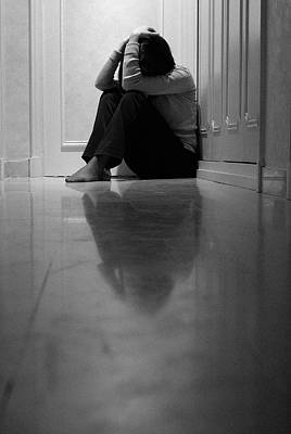 Woman Sitting In Corridor With Head In Hands Poster