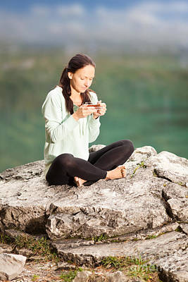 Woman Sitting On A Rock And Drinking Tea Poster