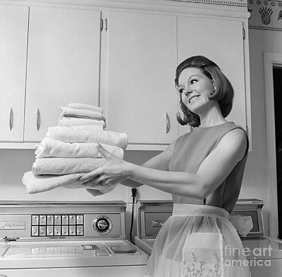 Woman With Folded Towels, C.1960s Poster by H. Armstrong Roberts/ClassicStock