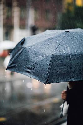 Woman With Umbrella In The Rain Poster by Aldona Pivoriene