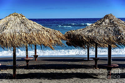 Wood Thatch Umbrellas On Black Sand Beach, Perissa Beach, In Santorini, Greece Poster