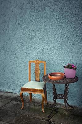 Wooden Chair And Iron Table Poster