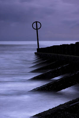 Poster featuring the photograph Wooden Groynes Of Aberdeen Scotland by Gabor Pozsgai
