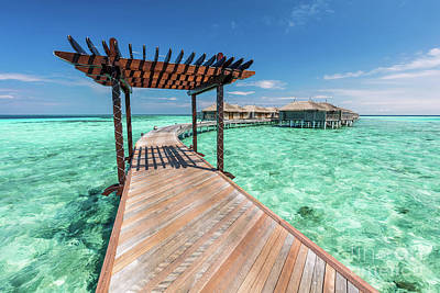 Wooden Jetty Towards Water Villas In Maldives. Poster
