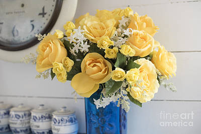 Yellow Flowers In A Blue Vase Poster