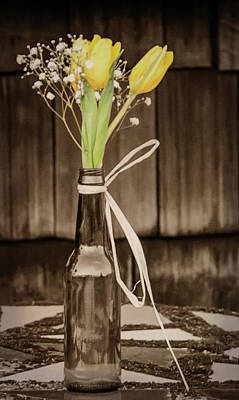 Poster featuring the photograph Yellow Tulips In Glass Bottle Sepia by Terry DeLuco