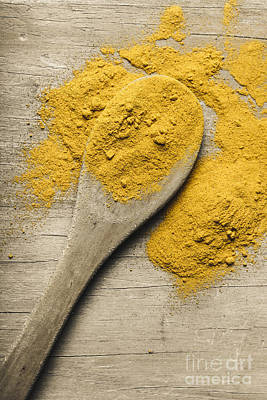 Yellow Turmeric Spice On Wooden Serving Spoon Poster by Jorgo Photography - Wall Art Gallery