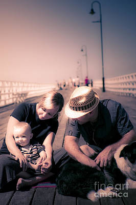 Young Couple And Baby Boy Sitting On The Boardwalk Poster by Jorgo Photography - Wall Art Gallery