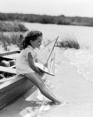 Young Girl At Seashore Holding Poster by H. Armstrong Roberts/ClassicStock