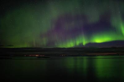 Aurora Borealis Reflecting At The Sea Surface Poster
