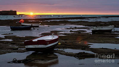 Poster featuring the photograph Beached Boats At Sunset Cadiz Spain by Pablo Avanzini
