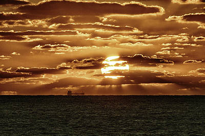 Poster featuring the photograph Dramatic Atlantic Sunrise With Ghost Freighter In Goldtone by Bill Swartwout Fine Art Photography