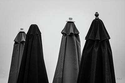 Poster featuring the photograph Four Umbrellas Bw by David Gordon