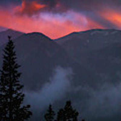 Sunset Storms Over The Rockies Poster by John De Bord