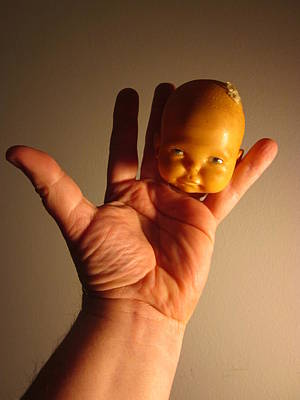 A Head Of A Doll And A Hand And Fingers As Body Make Up A Very Odd And Prints
