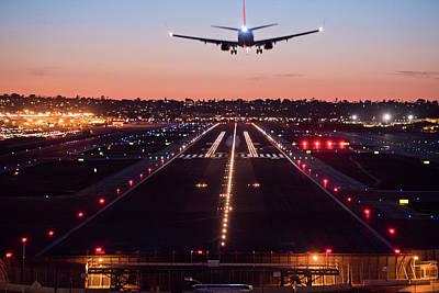 Designs Similar to A Plane Landing At Sunset