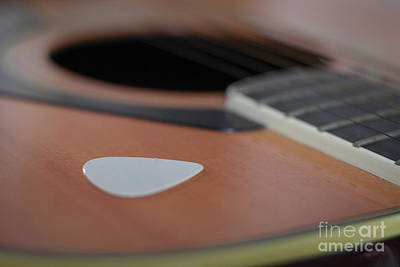 Photograph - Close up of guitar pick on body of guitar by Doug Moore