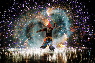 Photograph - Fire show performer at night by Philippe Lejeanvre