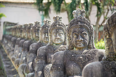 Photograph - Old statues in Cambodia by Travel and Destinations - By Mike Clegg