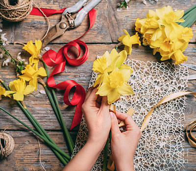 Photograph - Florist making bouquet of narcissus by Jelena Jovanovic