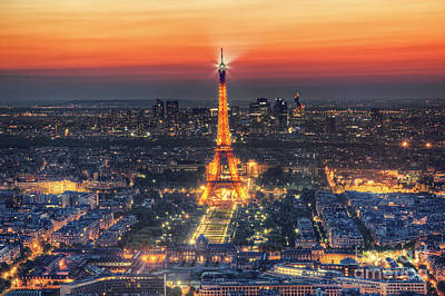Paris Skyline Royalty-Free and Rights-Managed Images -  Eiffel Tower Show at night at sunset by Michal Bednarek