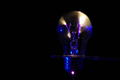 Photograph -  Light Bulb Sparks by Peter Kallai