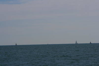 Photograph -  Four Yachts At Sea by Phoenix De Vries