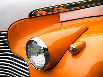 Headlamp Photograph - 1940 Orange And White Chevrolet Sedan by Carol Leigh