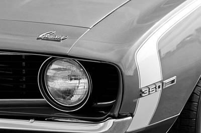 Headlight Photograph - 1969 Chevrolet Camaro Ss Headlight Emblems by Jill Reger
