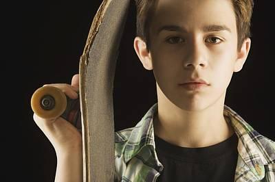A Boy With A Skateboard Art Print by Darren Greenwood