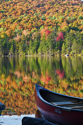 Canoe Photograph - A Canoe On The Shoreline Of Pond by Jerry and Marcy Monkman