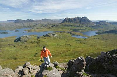 Craggy Photograph - A Climber On Stac Pollaidh by Ashley Cooper