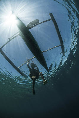 Images Of Ocean Canoes Photograph - A Fisherman Uses A Wooden Outrigger by Ethan Daniels
