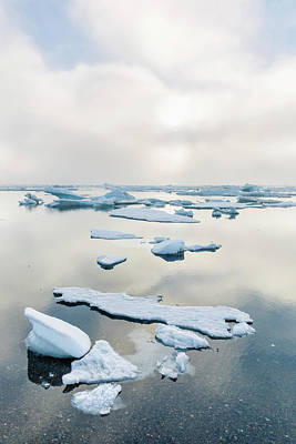 A Foggy Sunset Over The Arctic Ocean Art Print by Kevin Smith