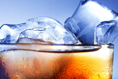 Still Photograph - A Fresh Glass Of Cola With Ice by Michal Bednarek