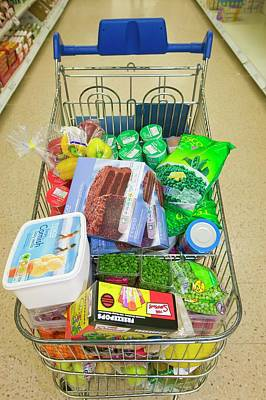 Supermarket Photograph - A Full Trolley Of Food by Ashley Cooper
