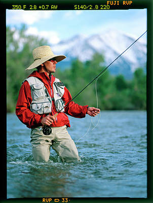 Colorado Fly Fishing River Wall Art - Photograph - A Man Fly Fishes In A River by David Clifford