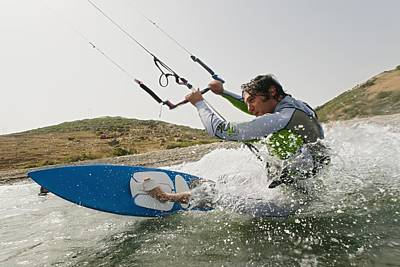 A Man Kite Surfing Off The Coast Of Art Print