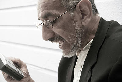Dictaphone Photograph - A Man With A Electronic Device by Ron Koeberer