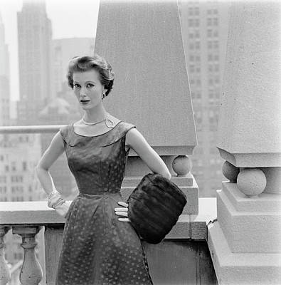 A Model Standing Against A Rooftop Column In An Art Print
