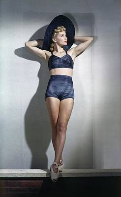 Pinstripes Photograph - A Model Wearing A Bathing Suit by Horst P. Horst