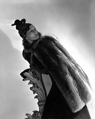Cape Lily Photograph - A Model Wearing A Fur Cape by Horst P. Horst