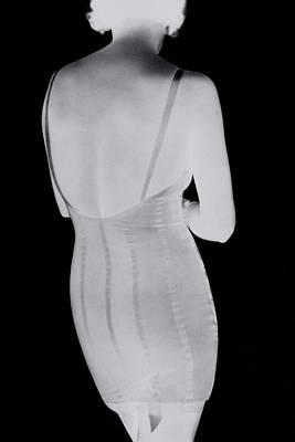Corset Photograph - A Negative Print Of A Woman Wearing A Corset by George Hoyningen-Huene