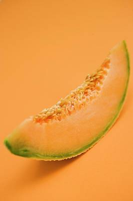 Cantaloupe Photograph - A Slice Of Cantaloupe Melon by Foodcollection