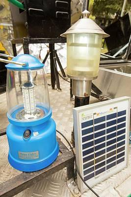 A Solar Lantern Powered By A Solar Panel Print by Ashley Cooper